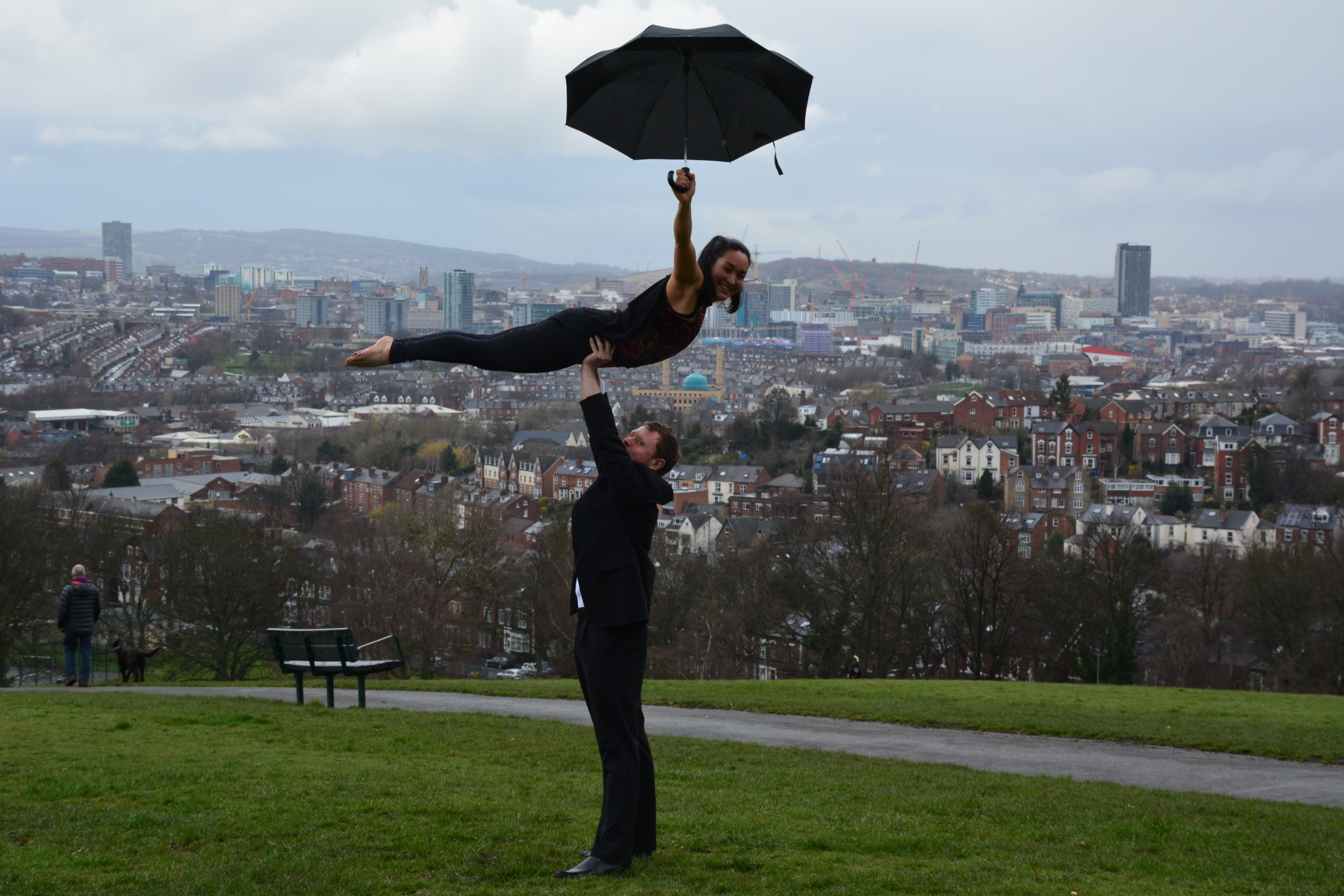 Tash holding an umbrella striaght high angel on duncan size 33%
